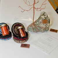 Taseko's gift to the WLIB: ore from Gibraltar Mine with a copper tree, symbolizing growth. WLIB's gift to Taseko, smoked salmon and hand woven baskets